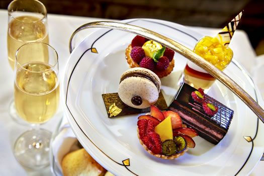 High tea pastry plate with two glasses of champagne